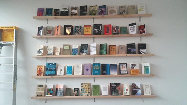 Zone 1 / Book wall [Resonant source material organized via contiguous association]