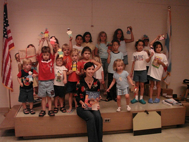 Rene and the kids with their beautiful paper dolls at the end of a fun library visit.