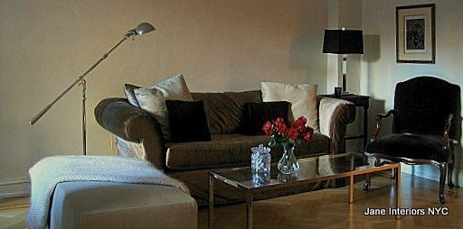 Warm neutrals and a mix of modern and antique furniture by Jane Interiors NYC