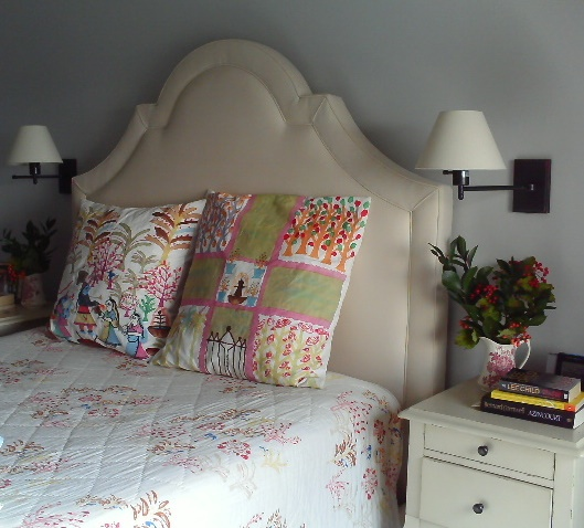 Upholstered headboard in a small bedroom by Jane Interiors NYC