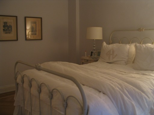 Simple off white bedding and furniture create a serene bedroom by Jane Interiors NYC