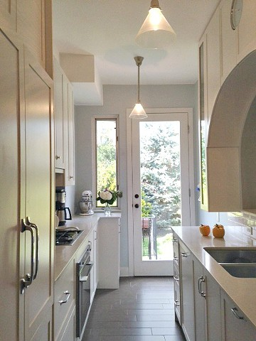Kitchen Designer, Brownstone Kitchen, Kitchen with white kitchen cabinets, kitchen with opening to dining room, galley kitchen, small kitchen design, narrow kitchen design, kitchen with bar, kitchen with arch