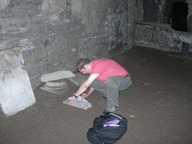 Making rubbing of inscriptions at San Crisogono, Rome