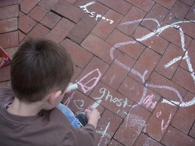 Visitors to The Box, playing with sidewalk chalk and telling ghost stories.