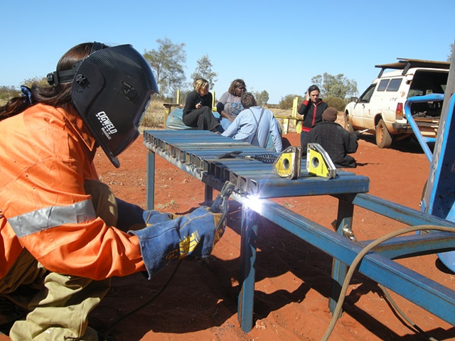 A local Kungka (unmarried woman) welding a bench.