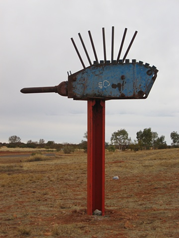 This sculpture points to the airstrip.