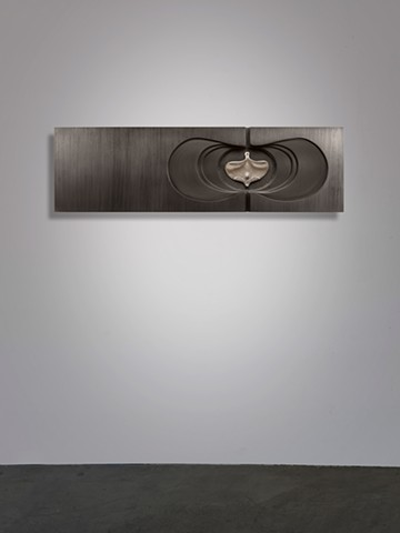 wall sculpture comprised of cast aluminum, wood, graphite, and sewing needle by Mary Meyer