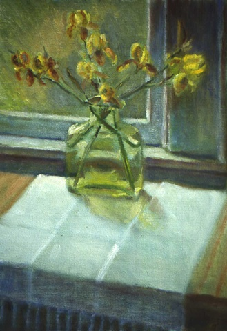 Yellow iris in green glass container  on white vintage cloth with fringe