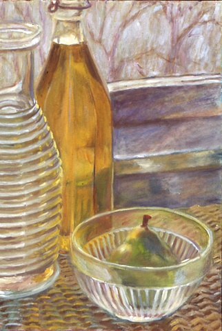 glass carafe and bowl with light on pear