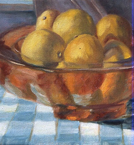 Lemons in orange glass bowl