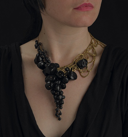 all black beads on this piece are hand made by artist