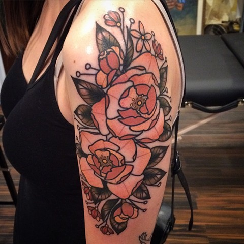 Traditional floral tattoo done at classic tattoos by Keller