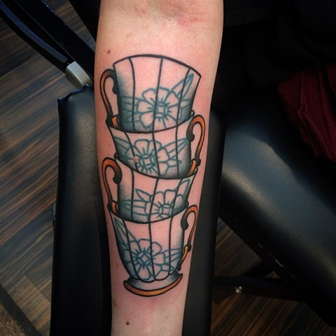 Traditional Tea Cups tattoo done at classic tattoos by keller