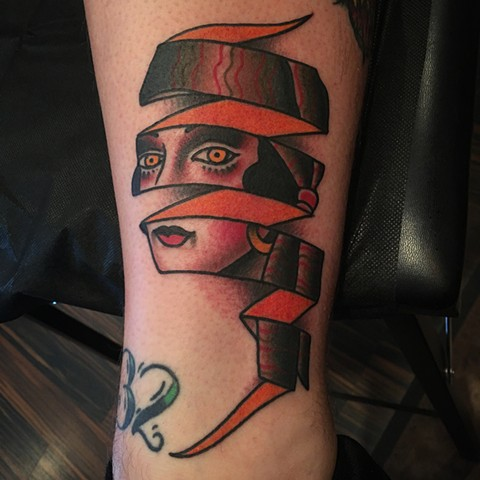 Traditional ribbon girl tattoo done at classic tattoos by keller