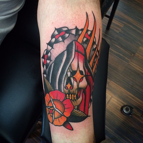 Traditional reaper in chains tattoo done at classic tattoos by Keller