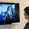Gallery visitor viewing the interview with the last, living relatives of Hansel and Gretel.