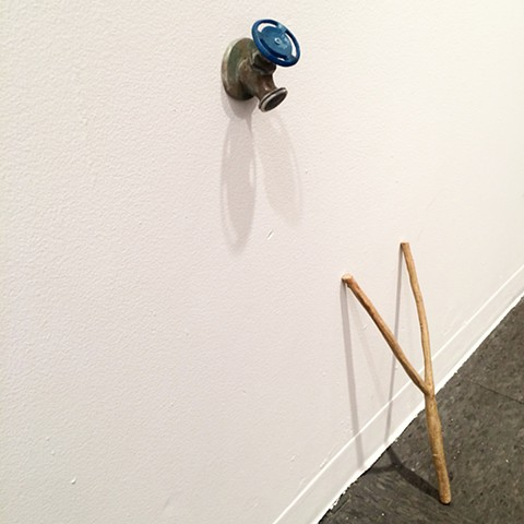 The Idea of Up (dowsing rod & water spigot) installation
