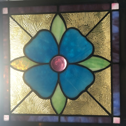 Flower with salvaged glass