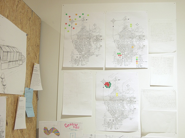 "'Vision/Voice/Plan: Salina,"" Salina Art Center, Salina, Ks. 2009. Resident maps in workstation."