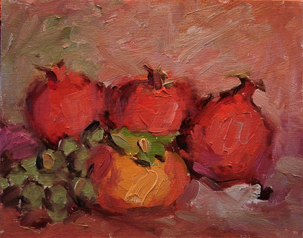 Still life of pomegranates, a persimmon and a bunch of grapes