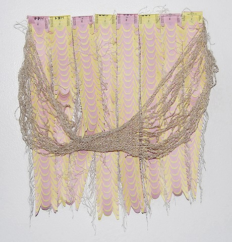 "Take-A-Number From Me, 2010. Machine-sewn Take-A-Number tickets and crocheted thread, 15""x14""x1""."