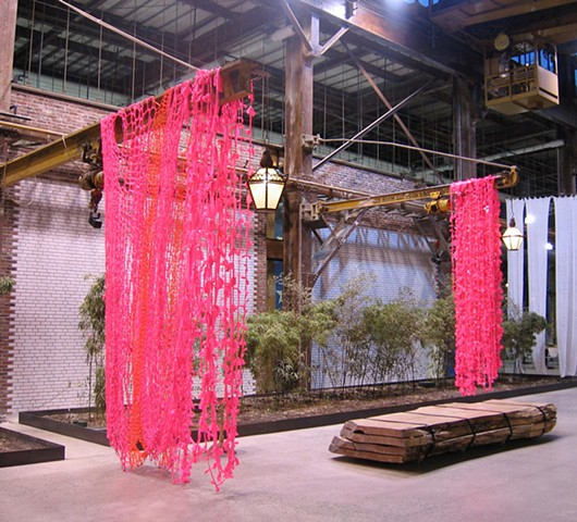 Ribbons and Bows, (Urban Outfitters Headquarters installation view, Philadelphia, Pennsylvania) 2011. Crocheted and knotted Glo-Pink fluorescent plastic flagging tape and children's barrettes, dimensions variable.