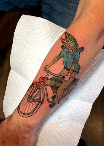 fish riding bike tattoo by dave wah at stay humble tattoo company in baltimore maryland the best tattoo shop in baltimore maryland