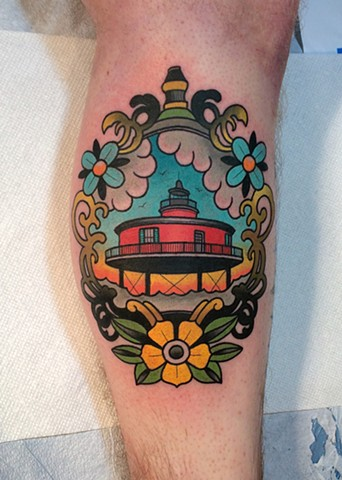 lighthouse tattoo by dave wah at stay humble tattoo company in baltimore maryland the best tattoo shop in baltimore maryland