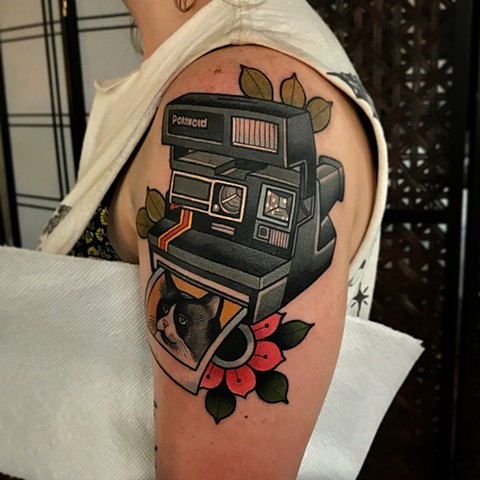 polaroid camera tattoo by dave wah at stay humble tattoo company in baltimore maryland the best tattoo shop and artist in baltimore maryland