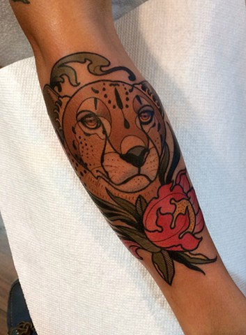 cheetah tattoo by dave wah at stay humble tattoo company in baltimore maryland the best tattoo shop in baltimore maryland