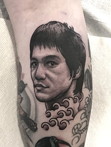 bruce lee portrait tattoo by tattoo artist dave wah at stay humble tattoo company in baltimore maryland the best tattoo shop in baltimore maryland