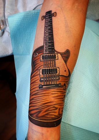 guitar tattoo by dave wah at stay humble tattoo company in baltimore maryland