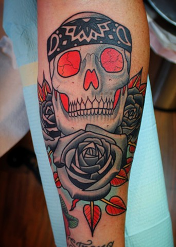 skull and roses tattoo by dave wah at stay humble tattoo company in baltimore maryland