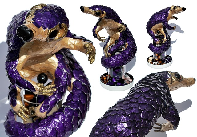 Pangolin sculpture upcycle recycle art sean e avery nespresso pods