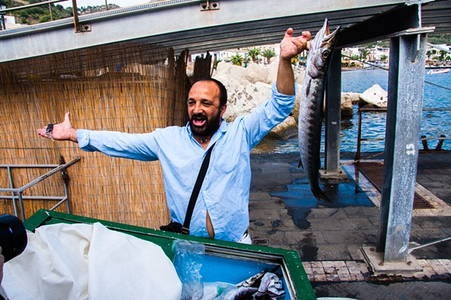 A fish vendor hawking his daily catch