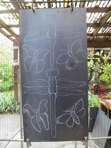 First Step:  chalk drawing on steel