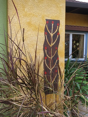 Tall steel panel in large pot.