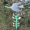 Bird flying with striped leaf