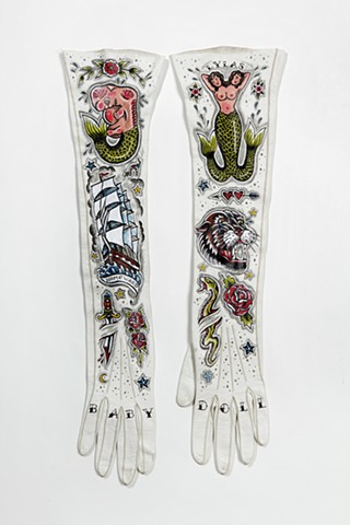 traditional tattoo designs of mermaids on vintage gloves