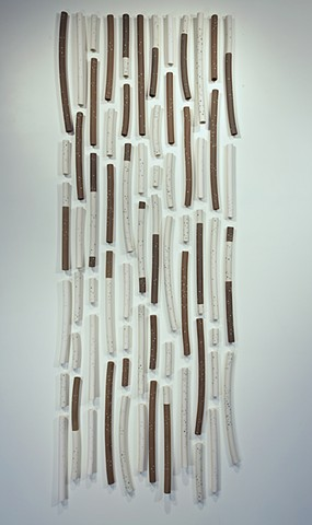 Multiple Porcelain and brown stoneware tubes with colored slip inlay. A study in falling water.