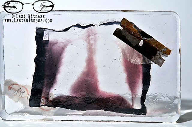 photo emulision of my fathers chest x-ray suspended in resin with rusted single edge razor blade