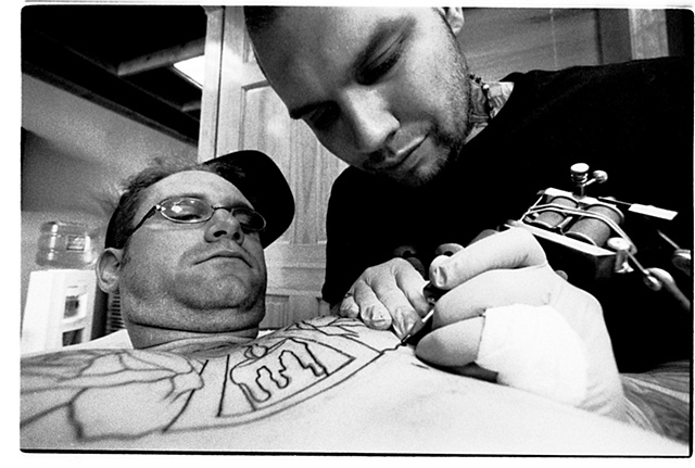 photographing myself getting tattooed