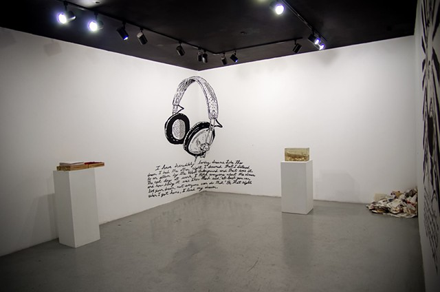 installation view of monologue show with wall drawing and sculptures