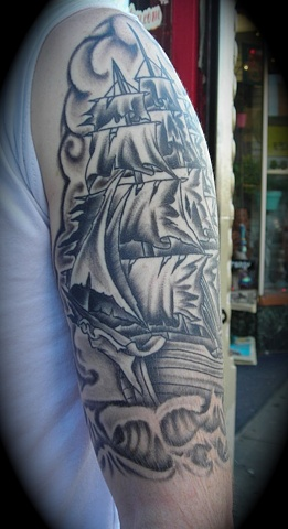 Black and Gray Ship on arm