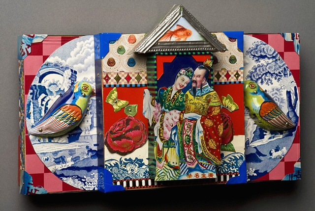 Recycled tin work of Asian couple surrounded by natures bounty by Jenny Fillius