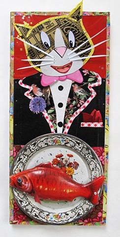 A dapper cat is excited by the fish on his plate.
