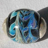Capped silver bearing bead