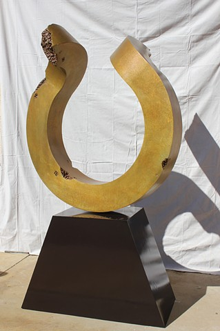 Patina on bronze with painted steel base. Free standing bronze sculpture.
