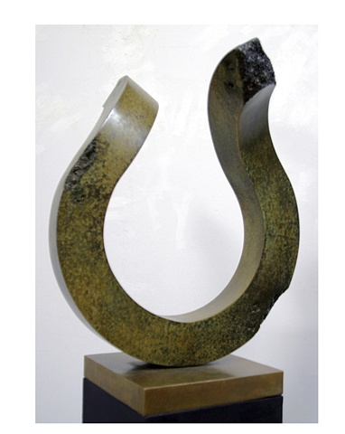 Pedestal bronze sculpture with green and gold patina on gold bronze base.