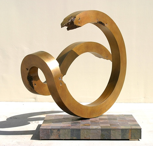 Large, outdoor bronze with golden patina.